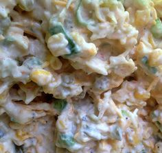 A Pinch of the Plains: Creamy Corn Dip - 2 8oz blocks cream cheese, 1 can corn (drained), 1 pkg dry ranch dressing seasoning, 2 chopped peppers ( yellow or red ), 1 can chopped green chilis ( in the Mexican isle ). Mix together and serve with Fritos.