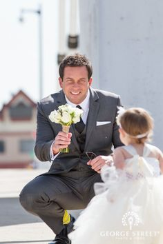 I can't decide what I love more about this picture — the groom's bright yellow socks or the precious flower girl!