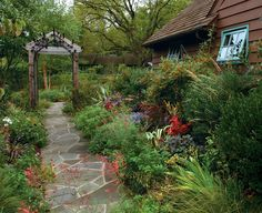 I don't agree with all of the particular plants and color combos...but I like the idea of the long walkway...