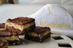 Washington Nanaimo Bars - Canadian confection, no bake bar cookies are three layers of goodness - chocolate graham/coconut/walnut crust, vanilla custard flavored butter icing, and rich chocolate Flavored Butter, Butter Icing, Butter Crust, Nanaimo Bars, Cake Recipes, Dessert Recipes, Delicious Desserts, Yummy Food, Brownie Bar
