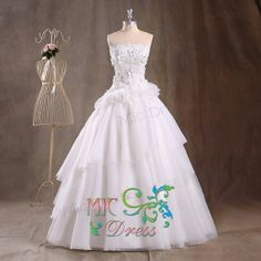 Strapless sleeveless floor-length organza with appliques and flowers wedding dress