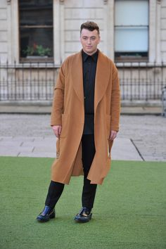 He can pull of a long coat that he probably uses to fly above the rest of us, singing softly while we sleep below, flapping his angelic wings as he soars. | 27 Reasons Sam Smith Is The Angelic Voice The World Needs Right Now