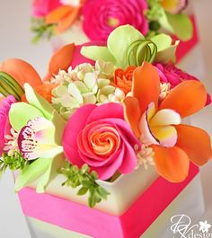 Orange centerpiece. Lots of vibrant orange party inspiration in the link.