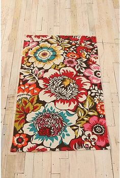 I want a house full of flowers and vibrant colors, but light walls and floors, so items like this rug stand out.