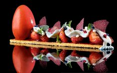 Tart of Strawberries with strawberry sorbet, almond biscuits, yoghurt cream, strawberry tuiles, and strawberry fluid gel by chef Heston Blumenthal.