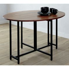 Shop Origami Drop Leaf Oval Dining Table.   A great staple for small spaces or multifunctioning rooms, the Origami Drop Leaf Dining Table is a Crate and Barrel exclusive.
