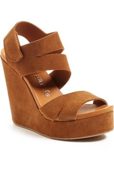 0d1c8c28cbe45c This soaring platform wedge boosts a chic and surprisingly comfortable  suede sandal made modern with angular