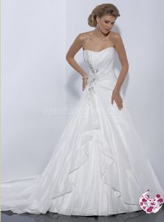 A-line gown with dipped neckline and corset closure
