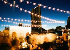 Really let the city shine by having a rooftop wedding like this one in Nashville. Strung lights give a romantic glow, but other than that you can keep the decorations simple — you've got a starry ceiling, after all.  Photo by Kate Murphy Photography