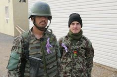 Afghan National Army soldiers display their purple ribbons in support of elimination of violence against women. #16days