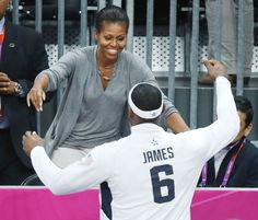 First Lady Michelle Obama hugs USA's Lebron James after USA defeated France in a preliminary men's basketball game at the 2012 Summer Olympics, Sunday, July in London Team Usa Basketball, Olympic Basketball, Basketball Photos, Olympic Team, Basketball Moves, Basketball Posters, Basketball Design, Olympic Gymnastics, Olympic Games