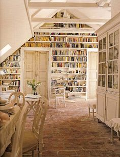 This rustic bookshelf wall in a Swedish loft is idyllic book lover decor inspiration.