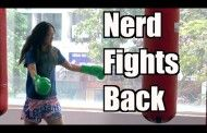 Pro female kick boxer dresses as nerd and beats up trainers