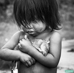 Little girl with dead rat