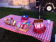 Outdoor movie night concession stand table set up ( minus popcorn and butter) daylight version
