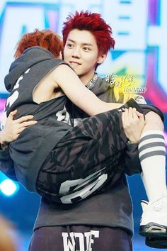 XiuHan. If LUHAN the princess can carry Xiumin, I think he's gotten too skinny…