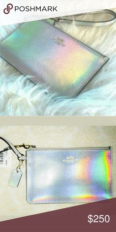 New! Rare Coach Hologram Irridescent Wristlet New with tags! This is the gorgeous rare and hard to find collectible Coach leather hologram holographic silver irridescent wristlet! This collector's Coach wristlet is so incredible with beautiful shimmery rainbows that sparkly in the light in brand new excellent condition made of high quality durable Coach leather. Awesome!! Coach Bags Clutches & Wristlets