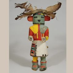 Hopi Pueblo Mona Katsina Doll - According to Barton Wright, the Mona Katsina functions as the River or Thunder Katsina and appears singly in the Mixed Katsina Dances. His function seems to be simply that of encouraging the flow of water.  He appears most often on Third Mesa and there is the possibility that he may be limited to that mesa.