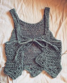 Another shirt on the hook... And big plans for when I get home in June so stay in touch. So excited! #crochet #crochetshirt #crochettop #shirt #top #homemade #handmade #diy #doityourself #ootd #fashion #spring #summer #festival #teal #turquoise #style #steeze #bamboo #soft #laceup #comfort #lace #project #design #customdesign by hann_made_