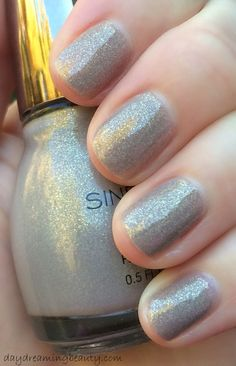 I finally found Sinful Colors Prosecco from Shining Bright Off the Runway collection. A gorgeous light gray/beige filled with gold shimmer. #SinfulShine #mani #notd