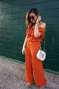 Off the shoulder Pom jumpsuit, wide leg jumpsuit, 70s style, jumpsuit and wedges, orange, preppy, cross body, Chloe bag dupe, chloe look-a-like bag, Karen walker leopard sunglasses