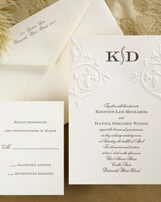 An embossed filigree design adds simple sophistication to this monogrammed invitation. Carlson Craft