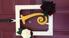 """A failed project left me with two 8"""" x 10"""" frames with a horrible paint job. Here's what I did with one. Yarn covered frame and letter from Hobby Lobby plus some felt flowers for a fall wreath."""