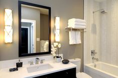 A guest bath should be as well-lit as your master bath. The handsome sconces flanking the mirror add targeted illumination and tremendous style.