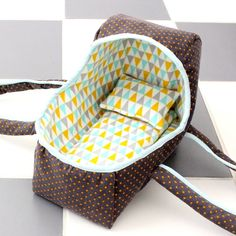 a baby basket bed for a doll or toy. :) pattern coming soon by DANA of MADE