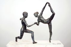 """Bronze sculpture """"Pas de Deux"""" shows a male and female ballet dancer who perform a choreography together. The French term """"pas de deux"""" means """"duet"""" and was often used in the early times of ballet to open a ballet performance. During the Baroque the couple danced synchronized, but later in the Romantic period, the man took a more supportive role during the act of pirouettes, arabesques and attitudes. The Pas de Deux is often used to express courtship and symbolizes the love between two…"""