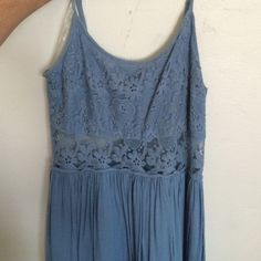 Blue dress size med Polyester dress from urban outfitters. Super cute, lace pattern on bust. Size medium. Fits me great and I'm a size 6. Never worn! Urban Outfitters Dresses Mini