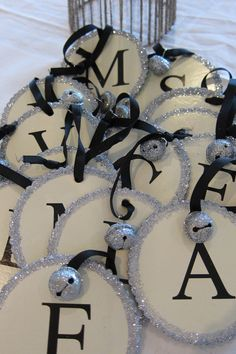 I could make these with a Cricut, some glitter, ribbon & bells from Hobby Lobby. Letter Ornaments, Diy Christmas Ornaments, Christmas Projects, Holiday Crafts, Holiday Fun, Christmas Decorations, Wooden Ornaments, Personalized Christmas Ornaments, Ball Ornaments