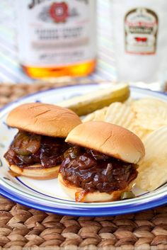 sliders//2 pounds ground beef (ground turkey would work be great too)   salt and pepper   4 Tbsp butter   1 large onion, diced   1/2 cup good whiskey   1 cup BBQ sauce   1/4 cup jarred sliced jalapenos   12 whole slider buns, split and toasted (dinner rolls work too!)