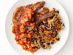 Quick Pork Chops With Rice and Beans    Ready to enjoy in just 30 minutes, this Cuban-inspired dinner boasts broiled pork chops topped with a simple tomato sauce and served with traditional rice and beans.
