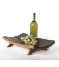 This functional work of art brings the natural shape of the wine barrel to your table. all wooden components of the bowl are made from parts of the wine barrel, making this truly a recycled product.