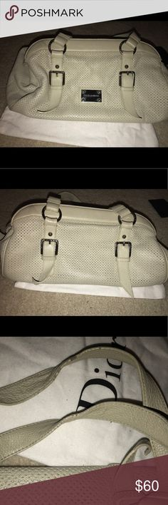 Dolce and Gabbana cream top handle bag Top handle Dolce and Gabbana cream bag with silver hardware. I have loved this bag thoroughly. It has wear on the straps and on the inside but still has plenty of wear left. Straps have an 11 inch drop. Bag's measurements are 15x7x6.5. Comes with authenticity card. Dolce & Gabbana Bags