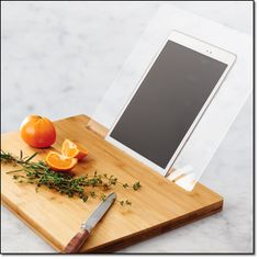 """2-IN-1 BAMBOO CUTTING BOARD WITH TABLET HOLDER Bamboo/plastic, hand wash only, 15"""" x 11"""" x 0.75"""" (tablet not included). Magalog: $29.99"""