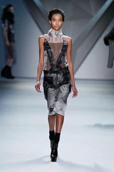 Grey vault print silk chiffon high neck sleeveless dress with crisscross cotton net appliqué and black vault print organza zip-front peplum with grey print stretch crepe bermuda short.