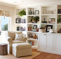 Reading nook interior designed with plush chair and ottoman to match lovely bookshelf: Laguna Beach