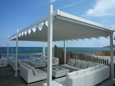 Gibus Group, leader in the production of awnings and pergolas for sun protection and energy saving Saint Tropez, Pavilion, Greece, Outdoor Structures, Country, Architecture, Beach, Furniture, Recherche Google