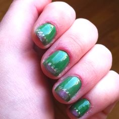 Green nails with metallic purple tips