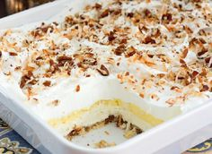 This coconut cream lush is a spin off of a fabulous dessert that's been rotating through Southern kitchens in a variety of flavors for decades. This version begins with a pecan shortbread crust, next a whipped cream cheese layer, then a thick layer of coc Kokos Desserts, Coconut Desserts, Layered Desserts, Pudding Desserts, Coconut Recipes, Köstliche Desserts, Delicious Desserts, Coconut Cream Cakes, Coconut Cream Dessert