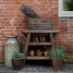 Country garden with wooden planting table and crate storage