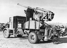 An Italian 90-53 gun on a truck mounting abandoned after the defeat of the Deutsche Afrika Korps.
