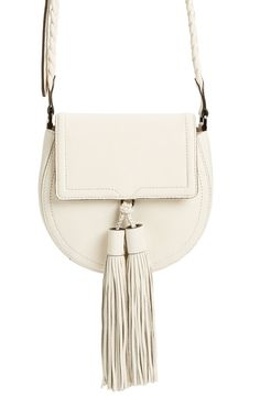 Oversized tassel embellishments add a cool, urban boho vibe to this classic saddle bag from Rebecca Minkoff.