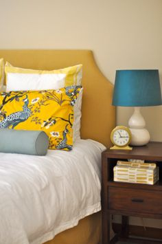 yellow in the bedroom. peacock pillow case and the lamp shade color.
