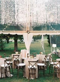 outside fall wedding reception under a clear tent - photo by Austin Gros