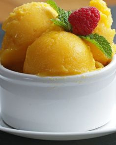 Customize & buy the Tasty Cookbook here: Here is what you'll need! Mango Sorbet Servings: INGREDIENTS 4 mangos, diced ½ cup honey ½ cup water PREPARATION Cut mangoes into ½-inch cubes and put on baking sheet. Cover and freeze for. Yummy Appetizers, Yummy Snacks, Yummy Food, Yummy Mummy, Yummy Eats, Mango Recipes, Ice Cream Recipes, Mango Dessert Recipes, Fruit Dessert