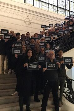 "Jean Paul Gaultier and his staff hold signs with the ""Je suis Charlie"" (""I am Charlie"") slogan. [Courtesy Photo]"