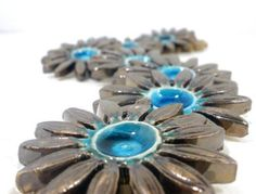Turquoise and brown ceramic flowers